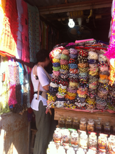 One of our crew shopping at Fatou's Secret. Belly beads, incense, lingerie… it's all here!