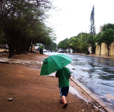 Going for a puddle walk last week. His froggie umbrella was a big hit.